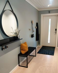A big round mirror in the hallway will add more depth, meaning your home will fe. - A big round mirror in the hallway will add more depth, meaning your home will feel bigger – and y - Decoration Hall, Entryway Decor, Wall Decor, Apartment Entryway, Decorations, Apartment Design, Entryway Bench, Apartment Ideas, Mid-century Interior