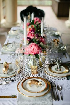 a glamorous setup involving peonies and gold figurines