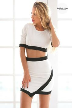 Pair this lovely black-lined white two-piece dress with a pair of pointed shoes and a stylish clutch to complete a sophisticated office lady look. Get one here.