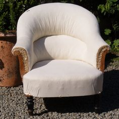 Small Tub chair covered in calico. Height: 80cm Width: 78xm Depth of seat: 54cm