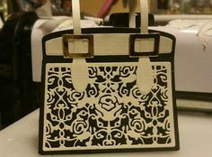 Made by Melissa - First go with the Kensington handbag die. Simple 2 tone black and beige, I've pearlised the cream with crafters companion pearl spray. Modelled on my current handbag.