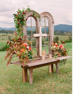 15 Fab Ways To Incorporate Antiques Into Your Wedding D Dont Have This Exact Vintage Window Backdrop But I Love How The Flowers Accent It And Compliment