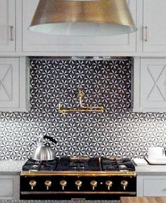 kitchen back splash with gold accents