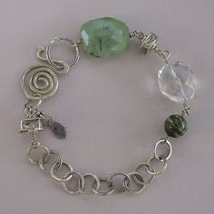 Gemstone bracelet. Faceted nuggets of prehnite and quartz crystal join zebra jasper and sterling silver beads on this bracelet of handmade sterling silver chain. Handmade sterling silver clasp. 7 1/2""
