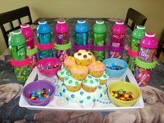 this is what I made for my daughters 9th birthday....cake idea from cake box and just added the extra m's in bowls. the goodie bags are water bottles filled with candy, finished with a slap bracelet around bottle...
