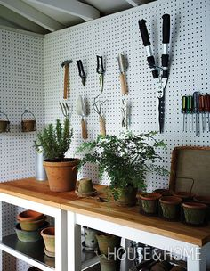 Display gardening tools artfully to prevent the space from getting too cluttered. | Photographer: Michael Graydon Designer: Stacy Begg & Lauren Petroff
