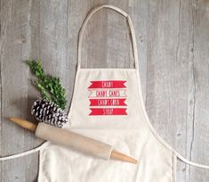 Calling all holiday bakers!! You know the quote!! ;) Adorable cotton canvas full apron by KITCH...Sure to please any chef or baker - PERFECT for your Christmas cooking and baking! Beautiful & sturdy, this is a 100% cotton, 14 ounce canvas apron. This is unbleached, natural cotton