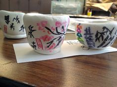 Asian Pinch Pot teacups...with crayola model magic and sharpie markers...these look awesome and I'm sure you only get that affect of the bleeding markers on the model magic...but I'd love to do it with older kids with the kiln fire clay as well!