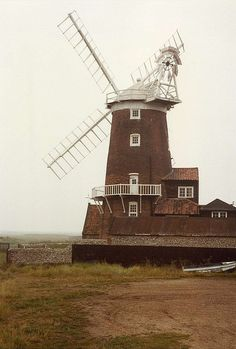 Cley-Next-The-Sea Windmill, Norfolk    		This windmill dates from 1713 and it is located in the village of  Cley-Next-The-Sea and by the banks of the River Glaven. It looks out  over marshes towards the sea embankments which protect Cley from the  North Sea, as it lies well below sea level.
