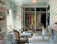 "Mary McDonald's dressing room, which features a lounging area reminiscent of an elegant dress salon, flame-stitch wallpaper, and a closet without doors to show off her wardrobe; photo by Melanie Acevedo, from the book, ""Mary McDonald Interiors: The Allure of Style"" (1 of 3) #closet #interior_design"