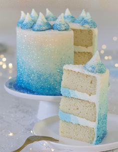A photo of a blue ombre cake with a piece in the foreground # frozen birthday cake Winter Wonderland White Chocolate Cake - Preppy Kitchen White Birthday Cakes, Frozen Birthday Cake, Frozen Party Cake, Glitter Birthday Cake, Sweet 16 Birthday Cake, Disney Frozen Cake, Glitter Cake, 5th Birthday, Birthday Ideas