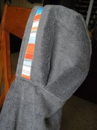 DIY Hooded Towel - made two of these tonight. It was pretty easy, except sometimes the layers got pretty thick. My sewing machine managed to power through! They turned out really cute and I love how big the hood is. I made them for gifts but I think next I'll make some for my own kid!