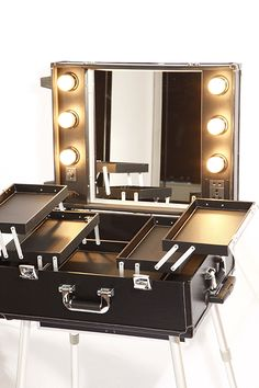 This Mobile Beauty Station is perfect for make­up artists or hairdressers/hair stylists. It features six light bulbs around the mirror and an electric socket which can be used for straighteners or any styling tools you need to use. The station also features storage compartments which are perfect for organising makeup and beauty essentials. The station folds down into a trolley, where the removable legs are hidden within the base –...Read More...