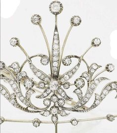 Detail of a late 19th century diamond and seed pearl tiara, brooch and pair of earrings