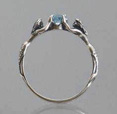 Two Mermaids Ring with Blue Topaz or Other Stone. $45.00, via Etsy.