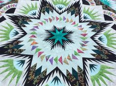 Glacier Star made and machine quilted by Kathleen Crabtree.