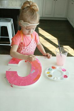 Such a cute idea to let the kiddos paint their own wall letters! Darleen Meier Jewelry via www.orsoshesays.com #art #craftsforkids.