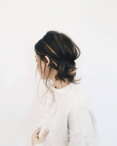 warm, hand-painted highlights + casual, low messy bun.
