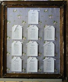 wedding table guestplan with floral decoration and wooden frame