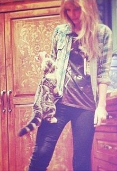 Meredith climbing up Taylor's leg!  <3