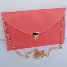 Envelope Clutch Purse Envelope clutch purse with golden chain which can be removable can be carried by hand or over the shoulder. Synthetic leather. Color watermelon. Good size to carry all you need. New! Boutique Bags Shoulder Bags
