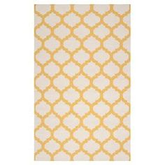 Hand-woven wool rug with a trellis motif.  Product: RugConstruction Material: 100% WoolColor: Ivory and goldFeatures:  Hand-wovenMade in India Note: Please be aware that actual colors may vary from those shown on your screen. Accent rugs may also not show the entire pattern that the corresponding area rugs have.Cleaning and Care: Blot stains