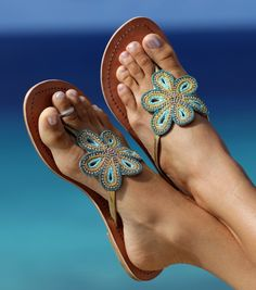The Bari Leather Sandal is an elegant beaded flower design on a nautral leather base. The crystal beads add glamour to any wardrobe, day or night.