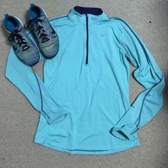 Nike 1/4 Zip Pullover Lightly used Nike Pullover. Has thumb holes and is Dri-Fit. It is also accommodated with a few reflective features on zipper and a strip on the sleeve. Nike Jackets & Coats