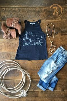 "- ""Dame of the Desert"" super soft vintage feel tank - Navy halter neckline tank - Distressed white cactus desert setting graphics - Great fit and feel ~ you'll want to live in it, I promise - Made in"