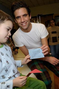 Mika loves Children so much and they seem to love him so much as well!