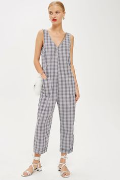http://www.topshop.com/en/tsuk/product/new-in-this-week-2169932/new-in-fashion-6367514/check-slouch-jumpsuit-7817596?bi=140