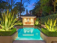 Geometric pool design using brick with outdoor dining & decorative lighting - Pool photo 178325