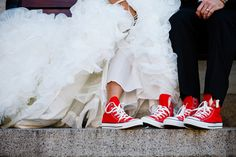 Who would have expected that under that diaphanous bridal gown lay a pair of red converse. We like the individual touch.