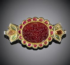 India | A Mughal gem-set jade and carnelian turban ornament (Sarpatti), engraved with Qur'anic inscriptions | ca. 1800, later mounted as a brooch | Est 4'000 - 6'000£ ~ (Oct '10)