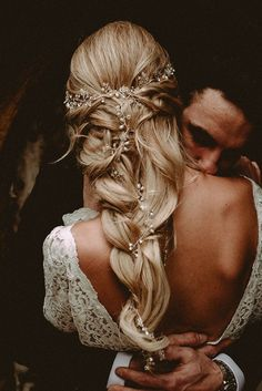 Beautiful wedding hair inspiration for a bride with long hair and wearing an open back wedding gown - a loose braid with hair vine. Image - Carla Blain Photography #WeddingLongHair #WeddingHair #BridalHair #weddingphotography