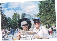 Gilbert & Lorraine Tafoya carving into The Taos News while visiting Mount Rushmore National Memorial in South Dakota.