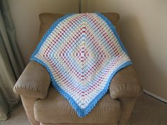 Soft & Wonderful baby blanket, Leisure Arts #2853 - easy & fast.  Rows of white DC alternated with rows of color SC/chain, like the little gem stitch at this link:  http://www.crochetspot.com/how-to-crochet-multi-colored-stitches-part-2/