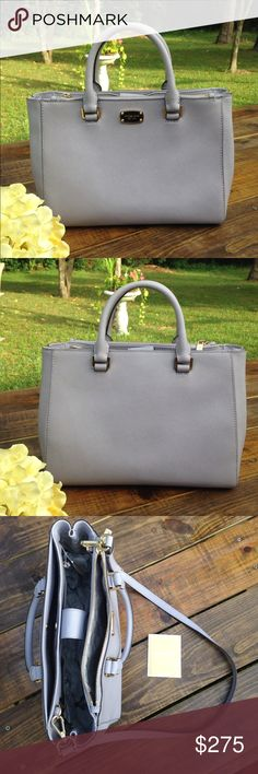 "Michael Kors Kellen Medium Leather Tote Lilac Gorgeous saffiano leather tote in lilac Dual rolled handles with 4"" drop Removable, adjustable, shoulder strap with buckle detail has 23"" drop Flat bottom with 4 gold tone feet Full length zipper pockets along outer top side, magnetic snap closure Interior lining in grey signature fabric 1 zipper pocket and 2 slip pockets 2 slip pockets along interior front wall            Top zipper closure All hardware in is polished gold tone Measurements…"