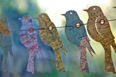 Get a bird stencil. Trace the birds onto decorative paper . Attach to string or wire and hang, Birds of the world garland.#garland #paperbirds by Esbech