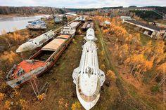 "Soviet Passenger Hydrofoils - Seriously amazing sight: retired ""heroes of the riverways"", rusting away in the autumn forest - near Kama Reservoir (Zaoszerskaya shipyards, near Perm).  http://www.darkroastedblend.com/2012/07/streamlined-soviet-passenger-hydrofoils.html"