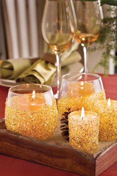 Get the Glow - December Inspirations - Southernliving. Brighten a room with this simple, festive idea. Dip a handful of glass votive holders in glue, roll them in gold glitter, and then insert candles. Their dancing flames will add a sparkling accent to any corner.