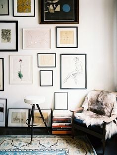 thin picture frames balanced by heavier textures + a corner seat