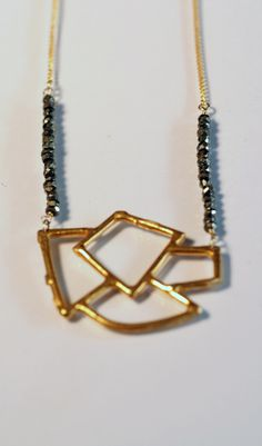 Pyrite and Gold Open Geo Necklace featuring faceted pyrite beads and gold-plated brass.