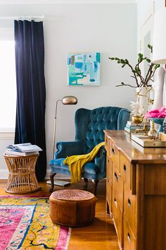 blue tufted wingback chair and that rug--all the right colors!