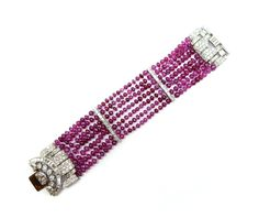 Art Deco seven row ruby bead and diamond cluster bracelet by Van Cleef & Arpels, Paris c.1934   , strung with polished ruby beads, to a stylised geometric buckle clasp set round brilliant, baguette and half-moon shaped stones, the rows with two intermediate diamond line spacers, signed Van Cleef & Arpels Paris, No. 42323, sprung clasp in white gold. Click to enlarge: http://assets7.pinimg.com/upload/137641332333090902_NEDQ0Wx4.jpg