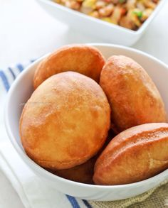 A Caribbean and Guyanese breakfast treat. Caribbean Coconut Bake is a fried dough that& usually served with saltfish, eggs or butter. Beignets, Carribean Food, Caribbean Recipes, Caribbean Bakes Recipe, Caribbean Johnny Cake Recipe, Jamaican Dishes, Jamaican Recipes, Jamaican Cuisine, Johnny Cakes Recipe