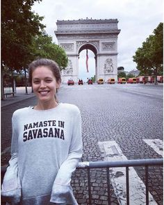 Love this shot of @EmilyDidonato wearing our NEW graphic tee in Paris. #aloyoga #beagoddess