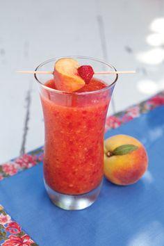 Peach Melba Daiquiri -   1 (20-ounce) bag frozen sliced peaches  1 cup frozen raspberries  1 (11.3-ounce) can peach nectar*  1 1/4 cups light rum  1/2 cup sugar  1/4 cup peach schnapps  2 tablespoons fresh lemon juice  Garnish: peach slices, raspberries