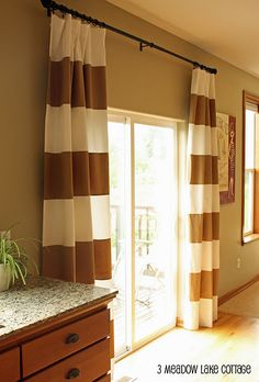 curtains for dining room- hang high to create illusion of larger room. I like the idea, but the stripes might be too bold.