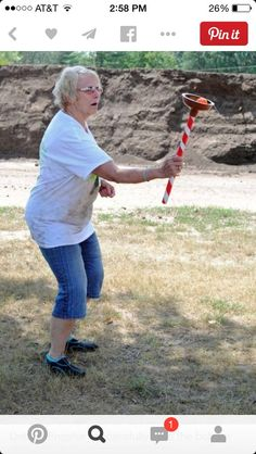 Debbie Engster successfully puts the bobber attached to the plunger on the top.---- several plunger games Nice job debbie Redneck Party Games, Redneck Birthday, 40th Birthday, Trailer Trash Party, Redneck Christmas, Western Christmas, Hillbilly Party, White Trash Party, Backyard Games